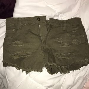 Army green ripped shorts